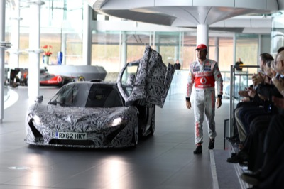 McLaren P1 gate-crashes F1 car launch