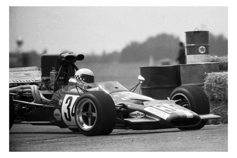 Wigram 1972. Teddy Pilette guides his McLaren M10B around the drums marking the loop and out onto Wigram's wide open track heading for Bomb Bay. IMAGE/terry marshall