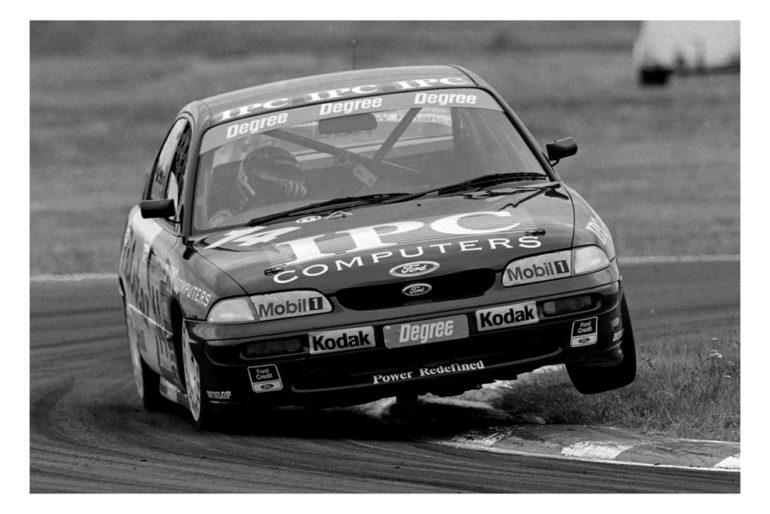 Ruapuna  96/97. Paul Radisich 3 wheeling the Telstar NZ Touring Car thru the second Ess on the original circuit. IMAGE/terry marshall