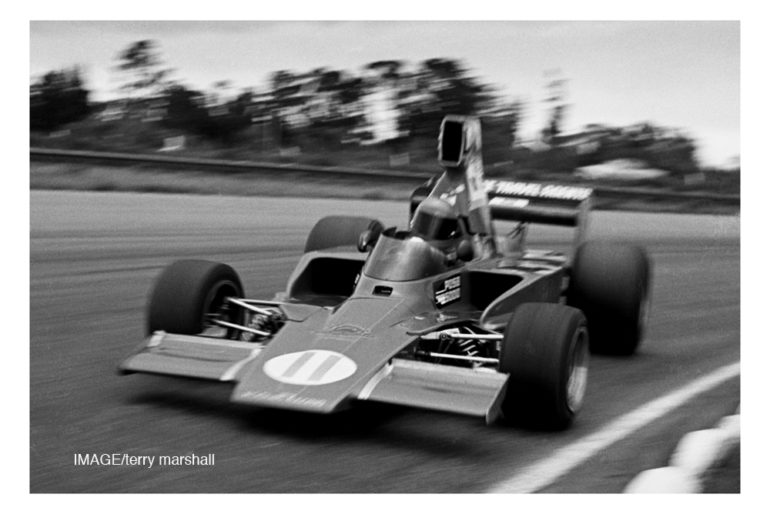 Ruapuna 1976. Ken Smith and his favorite race car the Lola T332  (HU8)  blasts passed my feet around Ruapuna's Rothmans sweeper. IMAGE/terry marshall