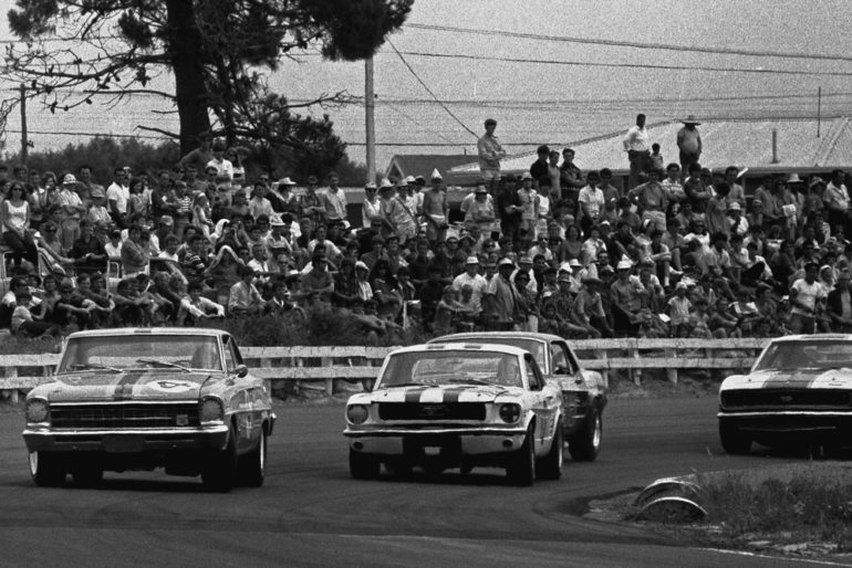 Baypark December 1968. Norm Beechey's Chevrolet Nova struggles with understeer in his efforts to hold off Paul Fahey and Red Dawson's Ford Mustangs. Spinner Black's Chevrolet Camaro about to join in the action. IMAGE/terry marshall