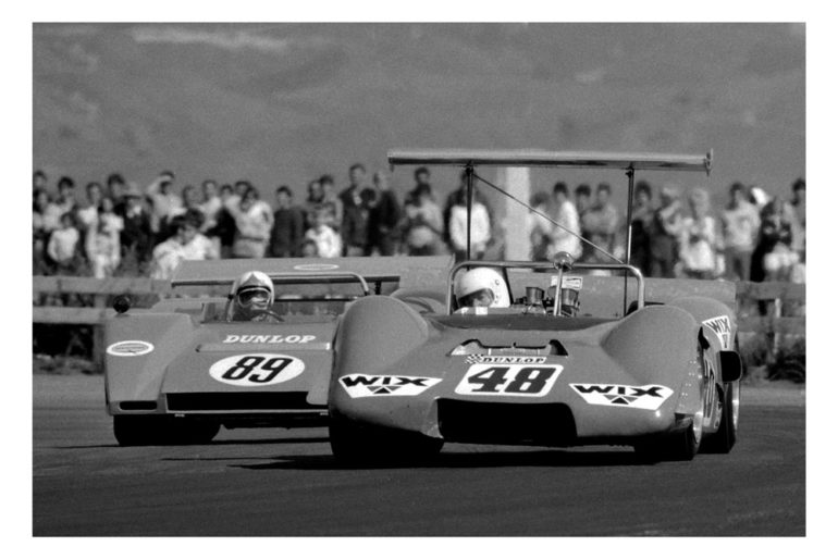 BayPark 1971. The days of the big engined sports cars. Grahame Harvey Elfin MR5 leading from Gary Pedersens GEMCO.  IMAGE/terry marshall