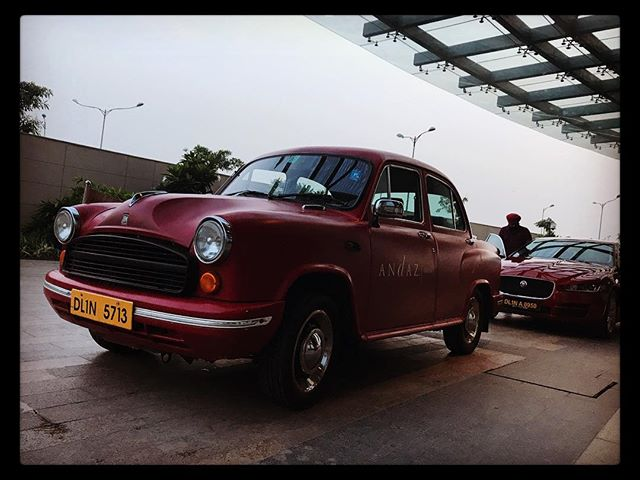 The two extremes of Indian cars: the brilliant Hindustan Ambassador and a Jaaaaag. The Ambassador has power steering. But that's about it…